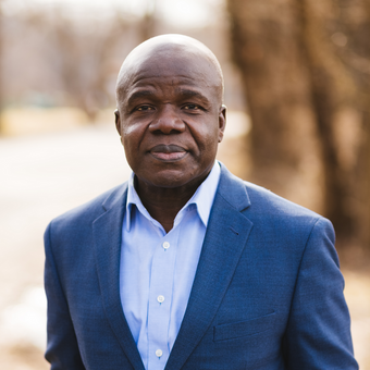 Charles  E. Owubah